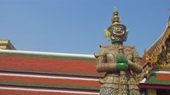Giant demon statue in Wat Phra Kaew in Bangkok Stock Footage