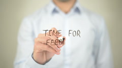 Time For Feedback , writing on transparent wall - stock footage