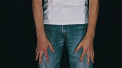 Man Turns the Empty Pockets of His Jeans. No Money - stock footage