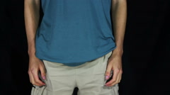 Man Turns the Empty Pockets of His Shorts. No Money - stock footage