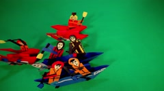 Animation Moving on Paper Kayak Figurines of People Top View Stock Footage