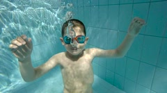 Boy in swimming pool Stock Footage