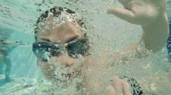 Smiling child swimming with fun - stock footage
