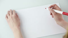 Female hands holding pen and blank paper sheets with copyspace on table. He - stock footage