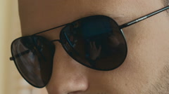 Hacker with sunglasses close up Stock Footage