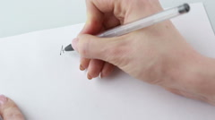 Female hands holding pen and blank paper sheets with copyspace on table. He Stock Footage