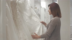 Women having fun during bridal gown fitting in wedding fashion store Stock Footage