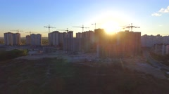 Construction site with many cranes at a big city. Aerial view - stock footage