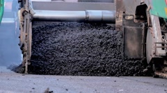 Asphalt paver machine during road construction, road construction crew apply Stock Footage