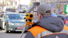 Engineers use tacheometer or theodolite for survey line in city centre, on a Stock Footage