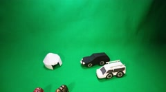 Animation of Moving Figurines Cars and Iron Figurines Around Paper Yurt Stock Footage