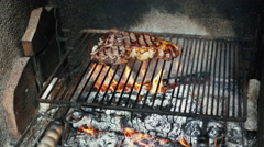 Roasting fiorentina meat on barbecue Stock Footage