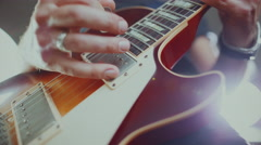 Guitarist playing live electric guitar Stock Footage