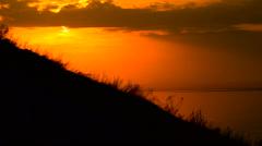 On the way to achieve the goal. motocross bike at sunset on hill climbs Stock Footage