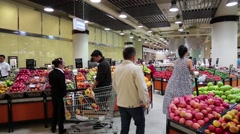 People near shop counter with fruits inside Dubai Mall, United Arab Emirates Stock Footage