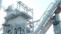 Modern asphalt plant in sunny day Stock Footage