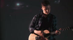 Man playing guitar on virtual scene Stock Footage