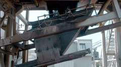 asphalt is poured into the trolley in modern asphalt plant - stock footage