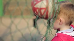 Head boy get the ball in the playground Stock Footage