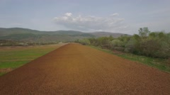 Aerial video over cultivated land in Bulgaria Stock Footage