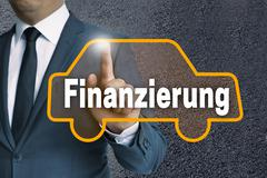 Finanzierung (in german finance) car touchscreen operated by businessman conc Stock Photos