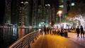 People on the waterfront, night Dubai Marina, United Arab Emirates Footage