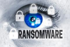 ransomware eye looks at viewer concept - stock photo