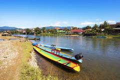 Boats on the Song River in Vang Vieng, Laos Stock Photos