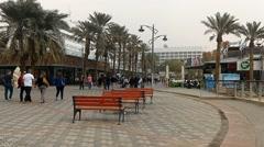 People walking in promenade near the beach in Eilat Stock Footage