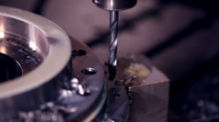 CNC milling machine makes steel part on a industrial factory Stock Footage