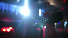 Microphone on a stage. slow motion. Woman hand touch microphone Stock Footage