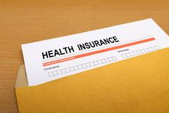 Health Insurance application form on brown envelope Stock Photos