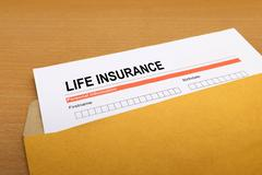 Life Insurance application form on brown envelope Stock Photos