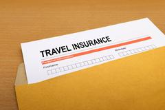 travel Insurance application form on brown envelope - stock photo