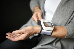 Woman wearing pulse watch Stock Photos