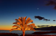 Sunset on beach with moonrise in Madeira insel, Portugal - stock photo