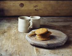 Wheat digestive biscuits on vintage wooden cutting board Stock Photos