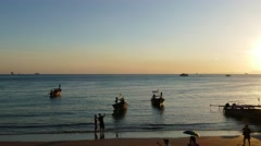 Long tail boats on Ao Nang beach at sunset Stock Footage