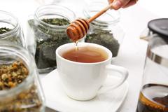 Tea sweetened with honey - stock photo