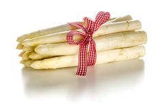 Bundle of fresh white asparagus on a white background Stock Photos