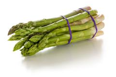 Bundle of fresh green asparagus on a white background - stock photo