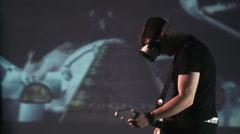 Man in oculus rift playing guitar 360 degree game Stock Footage