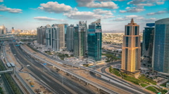 Aerial view of Dubai marina skyscrapers and Jumeirah lakes towers timelapse with Stock Footage