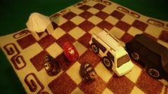 Animation of Moving Paper Models of Cars and Figures Near Yurt on Carpet of Stock Footage