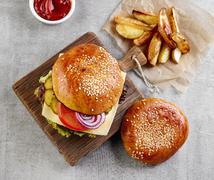 Cheeseburger and potato wedges - stock photo