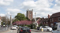 St Peters Church and busy traffic junction in St Albans, UK Stock Footage