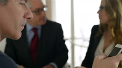 Young and dynamic business team, meet and talk in a busy modern office - stock footage
