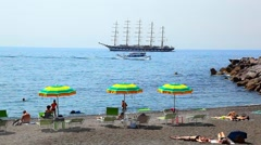 Luxury beach and Five-masted sailboat ship in town of Amalfi, Italy Stock Footage