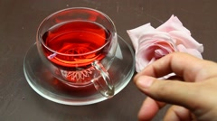Drinking Herbal tea and tea light candles. - stock footage