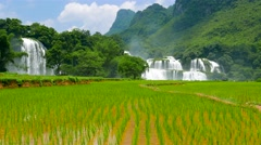 Ban Gioc Waterfall with rice field. 4K resolution. Vietnam - stock footage